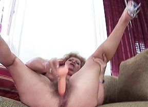Mature Franscina rides a dildo hard and long