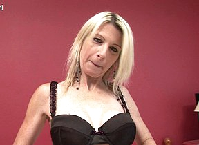 Blonde MILF rocking her dildo