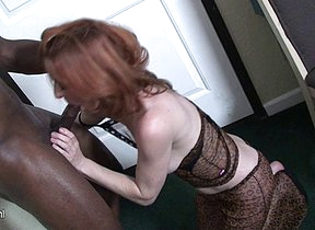 Red mature slut munching on a big black cock