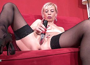 Blonde housewife playing with two toys