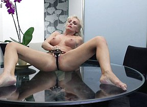 Horny MILF masturbating superior to before her glass table