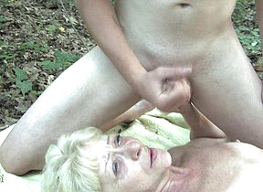 This naughty mature slut does two guys at once