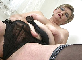 Naughty housewife playing with her toy