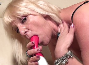 Horny blonde housewife playing with the brush toy