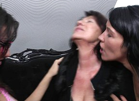 Three old and young lesbians make out on the couch and get wet
