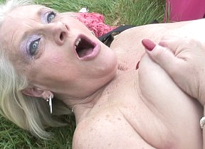 Naughty British housewife playing in the garden-variety