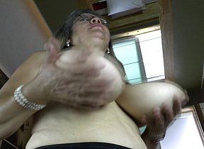 Heavy breasted mature slut playing with herself