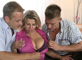 Big breasted housewife sucking added to fucking in a threesome
