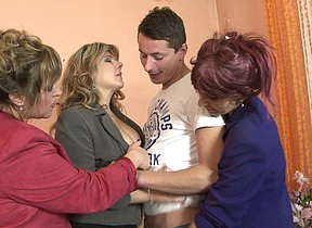 Three mature ladies sharing four hard cock
