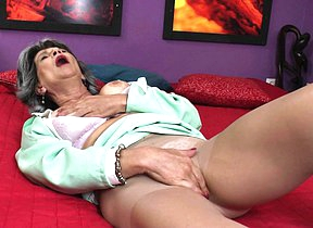 Horny mature battleaxe masturbating on bed