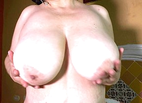 Big breasted Latin mama playing up her toy