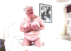 Big breasted British granny carryingon with herself