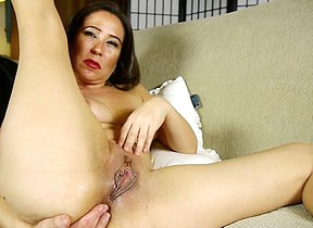 Naughty American mom masturbating on a catch couch