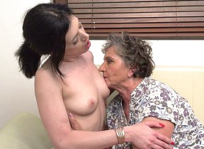 Hot lesbian babe licking a mature hairy pussy