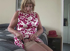 British mature lady shows her big tits and