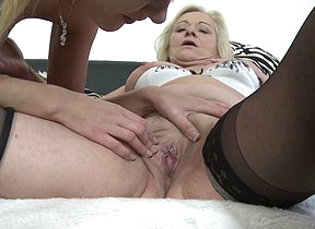 Two horny old and young lesbians licking and making out