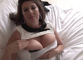 Big breasted British housewife getting very naughty