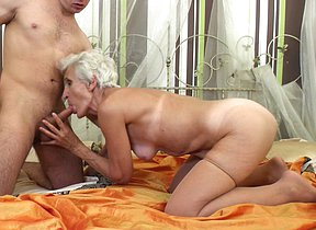 Hairy granny sucking and fucking her toy boy
