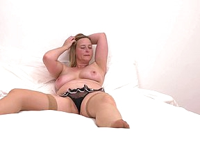 Horny British mammy playing with her unshaved pussy