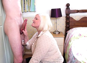 Chubby British housewife playing with her toy boy