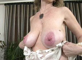 Naughty mature lady effectuation by herself
