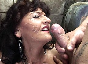 Horny mature battleaxe caught on a public toilet