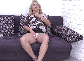 Chubby mature slut masturbating superior to before the couch