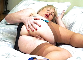Obese British mature slut playing with her pussy