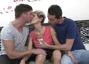 Mature slut sucking with an increment of shagging two guys at once