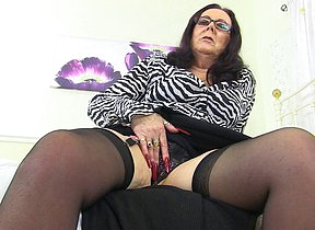 Horny British mature lsut playing with her trinket