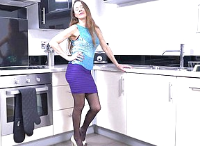 Muted British housewife playing in the kitchen
