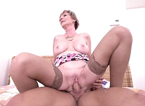 Horny mature slut fucking her musculated younger lover