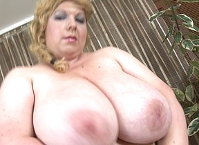 Huge breasted mature BBW playing with her scruffy pussy
