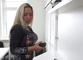Poisonous German mom playing with a cucumber