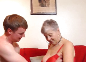 Naughty granny fucking and sucking her toy boy