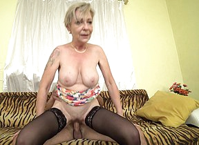This horny mature slut loves to shepherd a younger cock