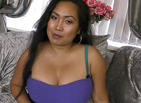 Big breasted Asian mom playing adjacent to her hairy pussy