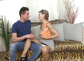 Naughty mature floozy doing their way toy boy  on the couch