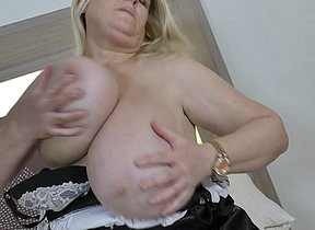Huge breasted British lady getting wet on her couch