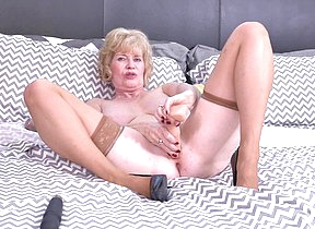 Hornmad American mature lady playing with her toys