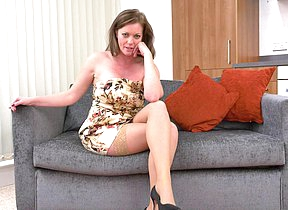 Roasting MILF playing with her pussy on the couch