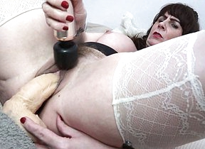 British housewife Toni Lace carryingon with her toys here bed