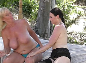 Two naughty lesbian cougars have fun in the sun