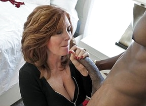 Hot MILF fucking and sucking a obese black cock