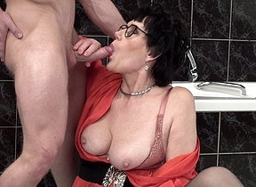 Naughty mature little one catching a toy boy in the bathroom