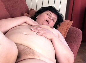 Aroused granny loves feeling her creamy pussy