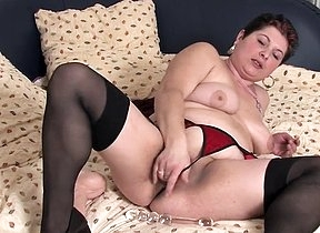 Nude mature solo porn showing a mature woman in