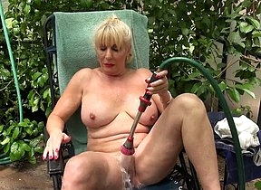 Along in the greenhouse and more than horny blonde mature starts to play with the hose over her pussy and eve pour water down her vagina and clit during steamy solo scenes