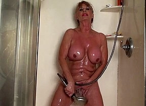 Horny old lassie enjoys the shower cap for some average solo action rubbing her clit in sensual modes with the addition of letting the water pour over her vag in a gaffer steamy accommodation billet solo