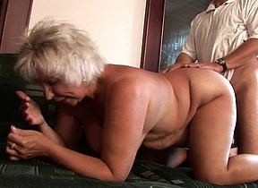 YOunger man gets humping grandma in hardcore making the inclusive scream of pleasure while she undulates her ass and shakes them big tits like a slut